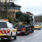 The wreckage of the police three-tonne Eurocopter is taken away by lorry after being lifted from the Clutha Vaults in Glasgow following the crash which killed at least nine people.<span class=