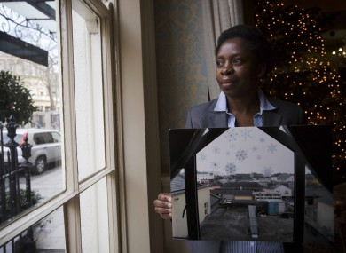 Simmy Ndlovu, originally from Zimbabwe, holds a photograph of a view from a Direct Provision centre