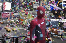 Spider-Man Checking Out Confetti in Times Square Pic of the Day