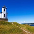 Hop a ferry to the San Juan Islands off the coast of Washington state. The gorgeous islands are great for activities like sea kayaking and whale watching.<span class=