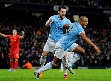 Kompany celebrates scoring the equaliser.