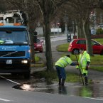 A crew from Dublin City Council work on an overflowing drain on the Howth Road in Dublin.<span class=
