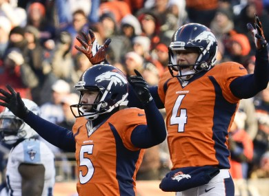 Matt Prater, left, celebrates with Britton Colquitt.