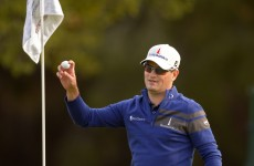 Zach Johnson brilliantly holes from the fairway to beat Tiger Woods in a play-off