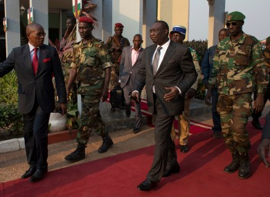 Michel Djotodia (centre) walks to board his plane to Chad on Wednesday.