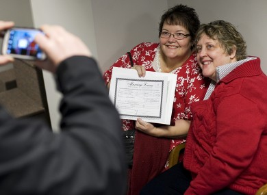 Cheryl Haws, right, and her partner Shelly Eyre have their photograph taken after receiving their marriage license at the Utah County Clerk's office in Provo, Utah
