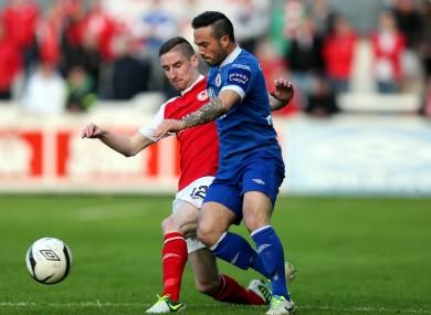 Ian Bermingham of St Pat's and Sligo striker Rafael Cretaro.