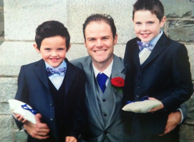 Stephen Carroll with his two young sons.