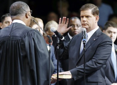 Mayor-elect of Boston Marty Walsh, right, takes the oath of office