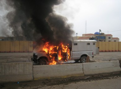 A police truck full of prisoners being transported was set afire by al-Qaida fighters on Wednesday