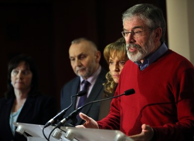 Sinn Fein President Gerry Adams with party colleagues speaks to the media at the Stormont hotel in Belfast, where all party talks chaired by Dr Richard Haass, failed to secure a deal.