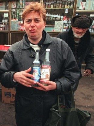 A Moscow woman holds two bottles of Russian-made vodka in downtown Moscow in 1997.