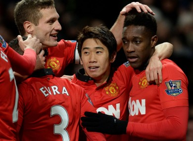 Manchester United's Danny Welbeck (right) celebrates with Shinji Kagawa and Nemanja Vidic.