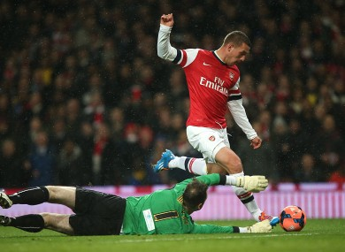 Arsenal's Lukas Podolski goes round Coventry City goalkeeper Joe Murphy to score his side's first goal of the game.