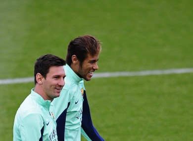 Messi and teammate Neymar during training yesterday.