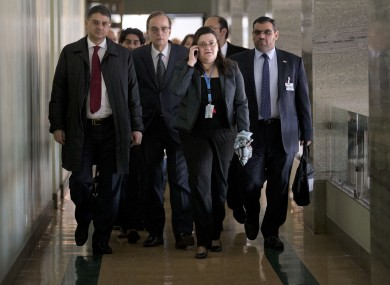 Members of the Syrian National Coalition, Syria's main political opposition group, arriving for a meeting with U.N. mediator Lakhdar Brahimi at the United Nations headquarters in Geneva