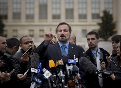 Louay Safi, center, spokesperson for the Syrian National Coalition, Syria's main political opposition group.