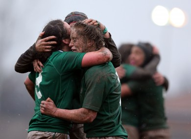 Claire Molloy, Larissa Muldoon and Joy Neville celebrate Ireland's Grand Slam win last year.