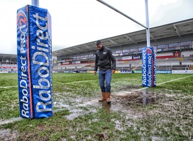 Referee Leighton Hodges looks at the mud.