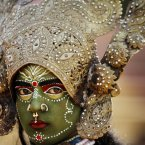 A women dressed as Hindu Goddess Kali participates in a procession on the eve of Shivratri festival, in Jammu.<span class=