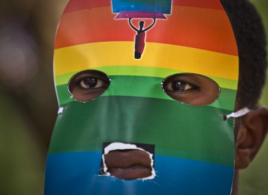A person wears a mask as Kenyan gays and lesbians protest against Ugandan laws