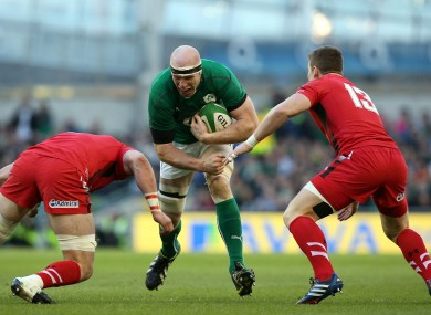 Paul O'Connell charges at Dan Lydiate and Scott Williams of Wales.