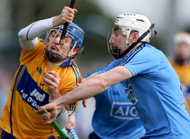 Clare's Shane O'Donnell and Dublin's Peter Kelly.
