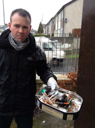 Wicklow County Councillor John Brady with syringes he found in a boarded up council house.