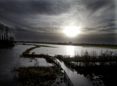 Floody hell: A watery winter sun rises above storm-ravaged countryside on the Kildare/Laois border on 2 January this year.