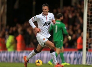 Manchester United's Robin van Persie celebrates scoring his side's first goal of the game from the penalty spot.