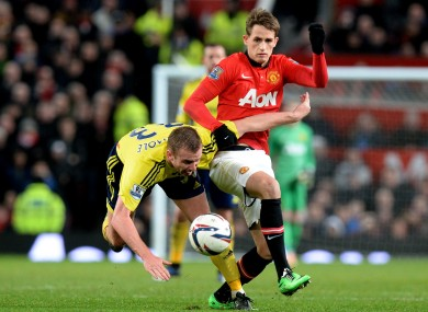 Manchester United's Adnan Januzaj (right) battles for the ball with Sunderland's Lee Cattermole.