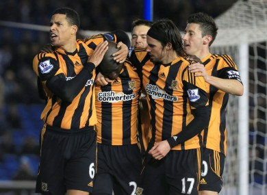 Hull City's Yannick Sagbo (second from left) is congratulated by team mates after scoring the equalizer for his side.