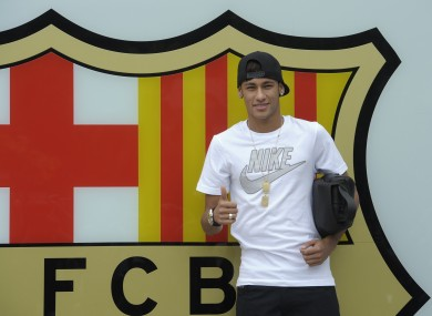 FC Barcelona's then new signing Neymar gestures upon his arrival at the club's office at the Camp Nou stadium in Barcelona, Spain. A Spanish court has charged Spanish league champion Barcelona with tax fraud of € 9.1m over the transfer of the Brazil star.