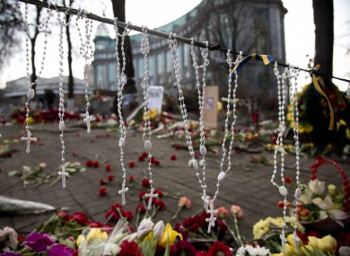 Rosary beads hang on a barricade in Kiev's Independence Square
