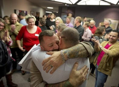 A couple embrace after being married in Salt Lake City, Utah, in December.