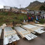 The government quickly supplied new sheets of tin for residents to rebuild their homes.<span class=