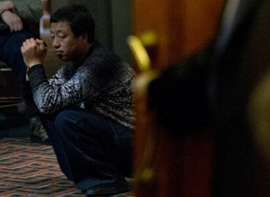 One of the relatives of Chinese passengers aboard missing Malaysia Airlines Flight MH370 waits to attend a briefing meeting with Malaysian officials in a hotel ballroom in Beijing
