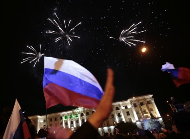 Pro-Russian people celebrate in Lenin Square in Ukraine last night