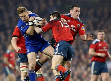 Ian Madigan competes with Felix Jones for a high ball.