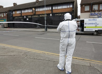 Garda forensics teams outside the Cabra House pub.