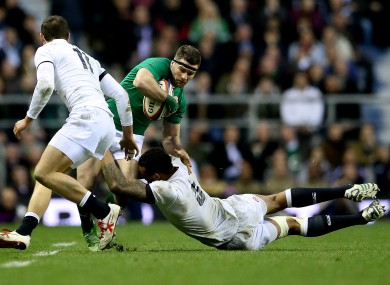Fergus McFadden is tackled by England's Courtney Lawes.