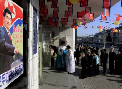 Voters line up to cast their ballots to elect deputies to the 13th Supreme People's Assembly in Pyongyang.
