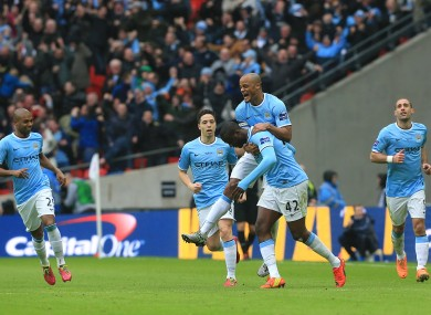 Manchester City's Yaya Toure (2nd right) is congratulated by his team mates after scoring the equalising goal.