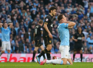 Manchester City's Edin Dzeko reacts after a missed chance.