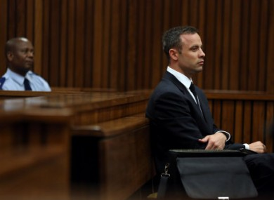 Oscar Pistorius, listens to ballistic evidence being given in court in Pretoria.