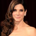 We know you can't see the dress, but look how good Sandra Bullock's face is. <span class=