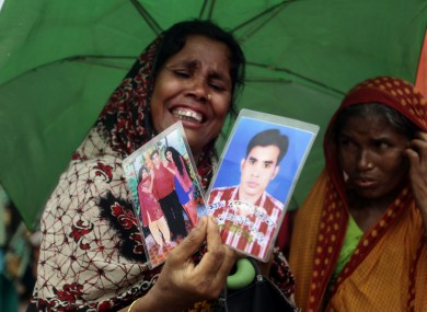 A Bangladeshi woman cries for her missing relatives at a ceremony last August