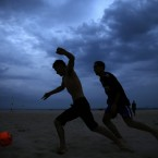 Brazilians and tourists play soccer on Copacabana beach, in Rio de Janeiro. With the World Cup weeks away, Brazil has been struggling to get the country ready for the World Cup. Infrastructure work is far from completed and violent clashes continue to flare up in several cities. (AP Photo/Hassan Ammar)<span class=