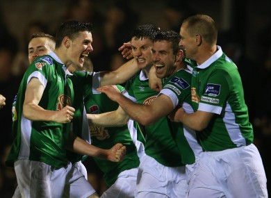 The Cork players celebrate Mark O'Sullivan's goal.