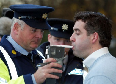 An actor is breathalysed during a mock drink driving test.